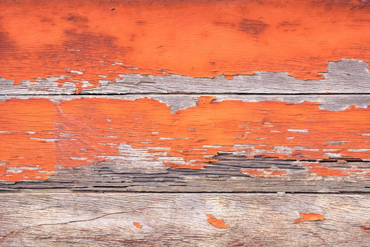 wooden boards with chipped orange paint, interior design mistakes