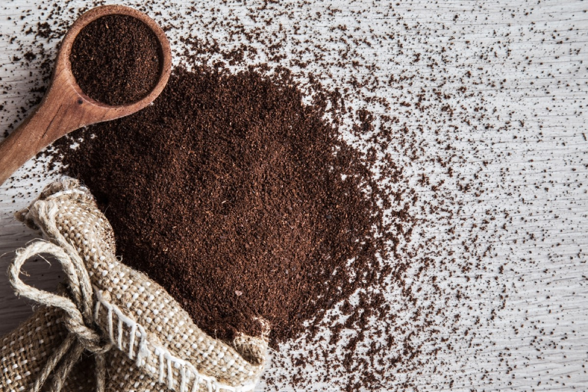 coffee grounds and wooden spoon