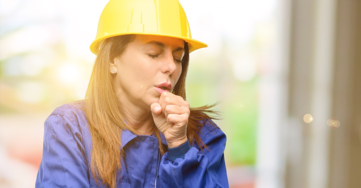 Construction worker coughing woman