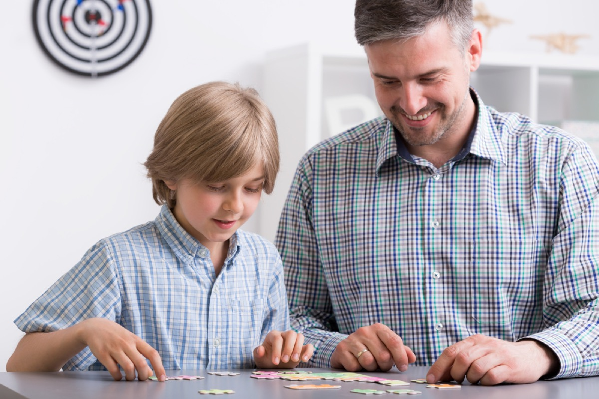 man and boy doing puzzle together, ways to feel amazing