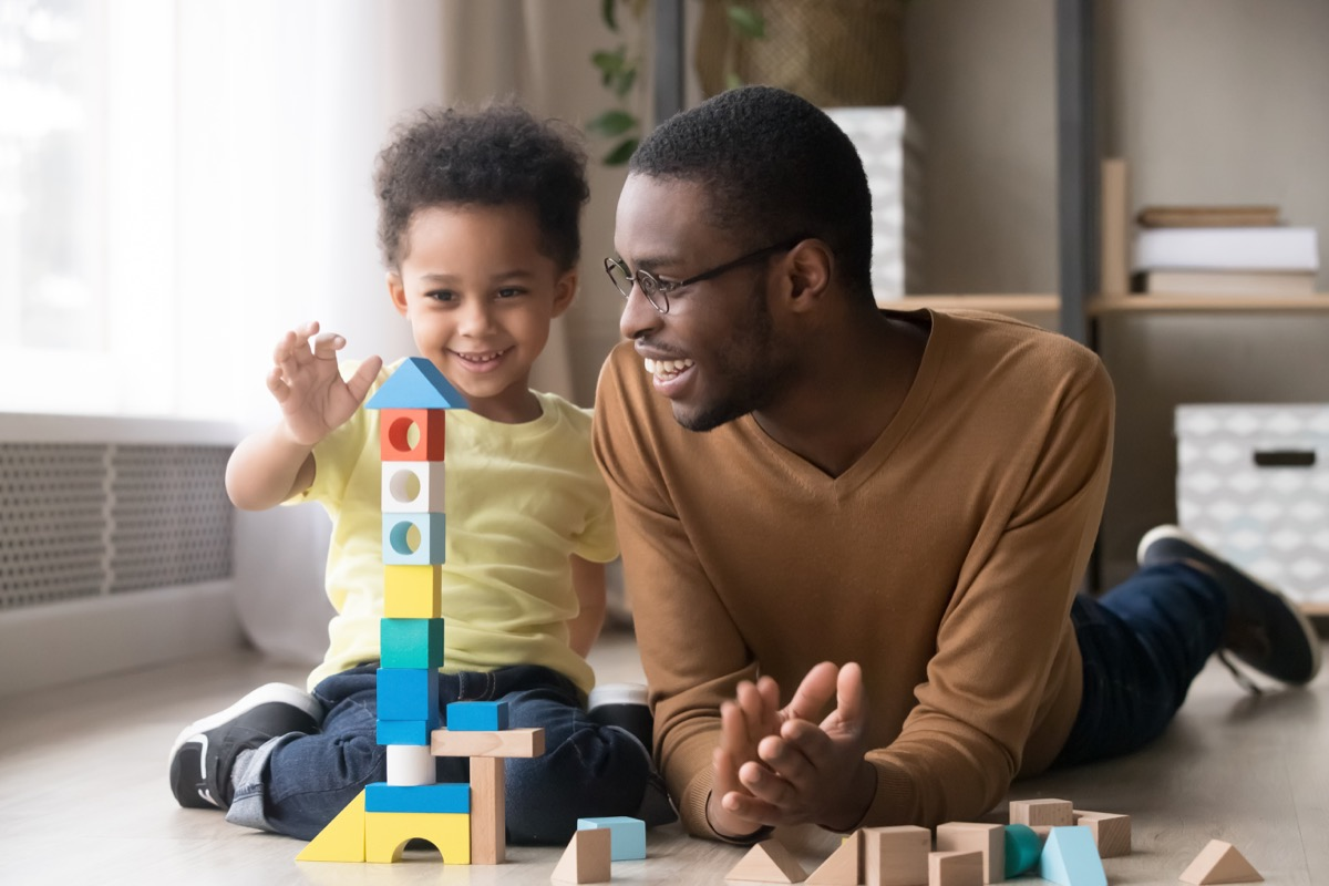 Dad playing with his toddler son things men won't admit