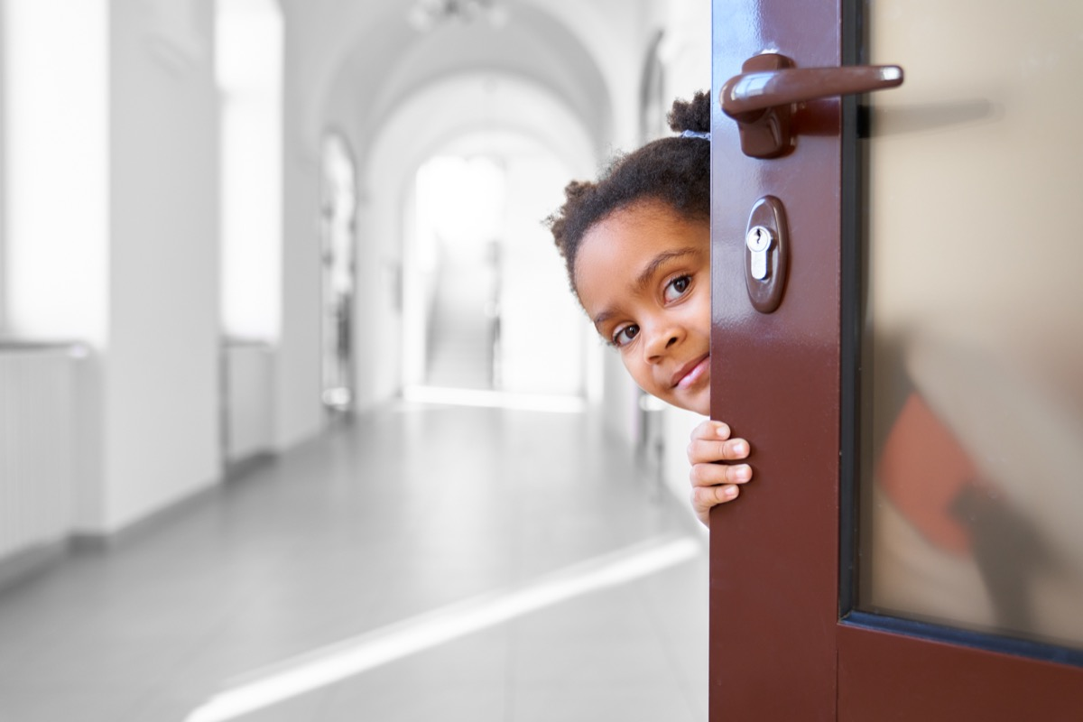 girl holding door open old-fashioned manners
