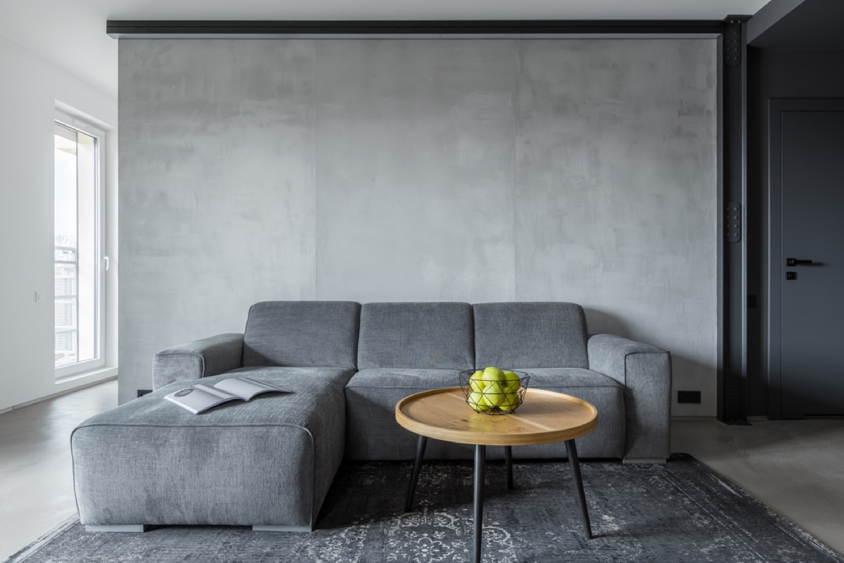 gray living room couch, interior design mistakes