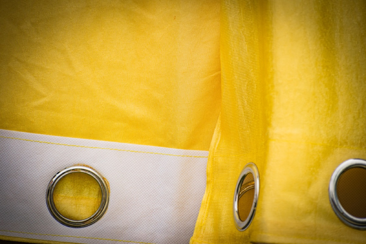 yellow grommet topped curtains, interior design mistakes