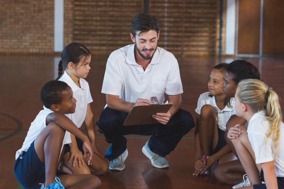 gym teacher with children old-fashioned manners