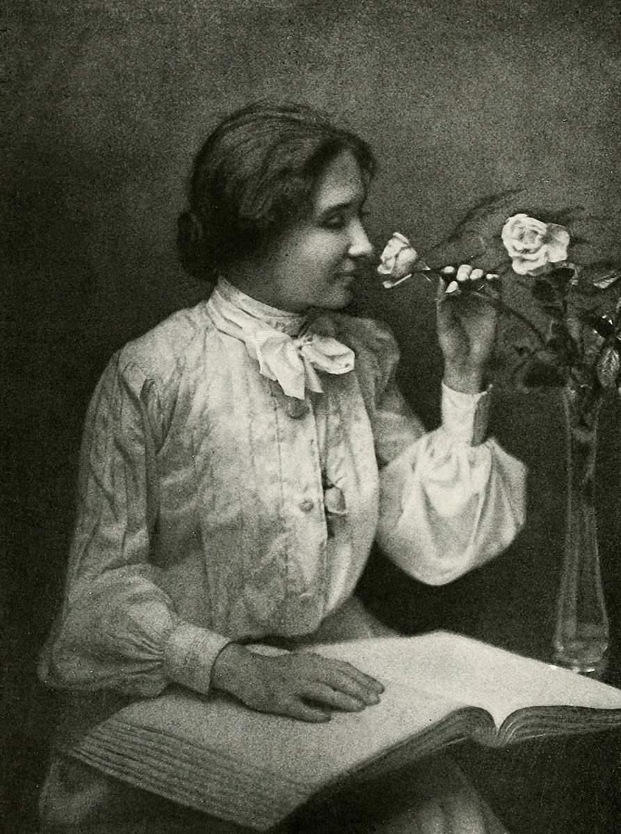Helen Killer with book and vase of flowers