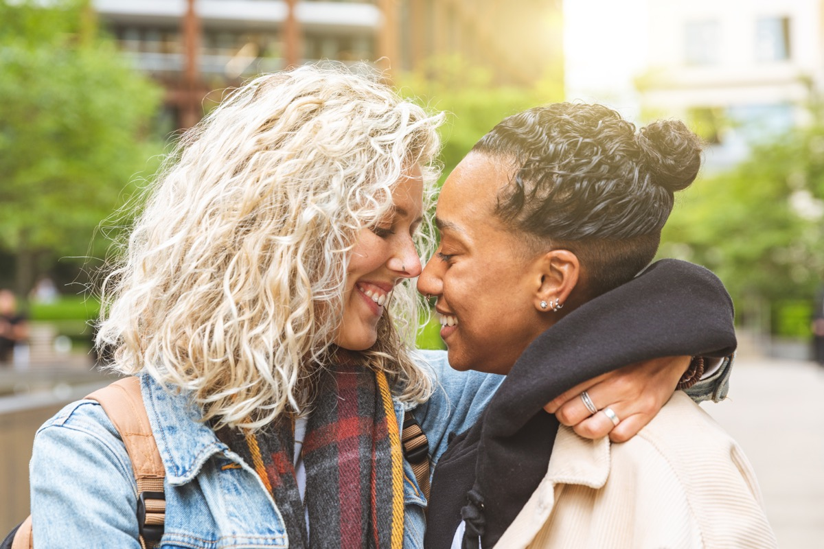 Happy multiracial girlfriends in love embracing