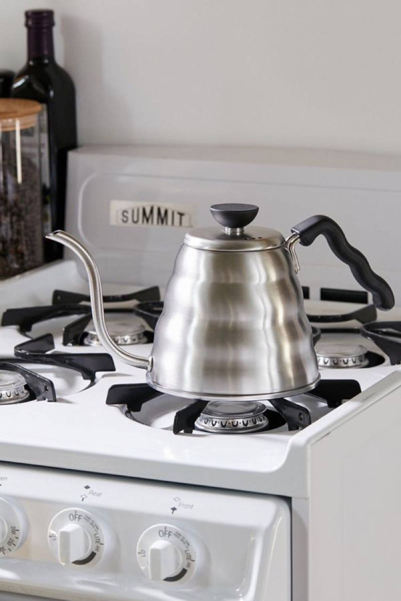 silver kettle sitting on top of gas range