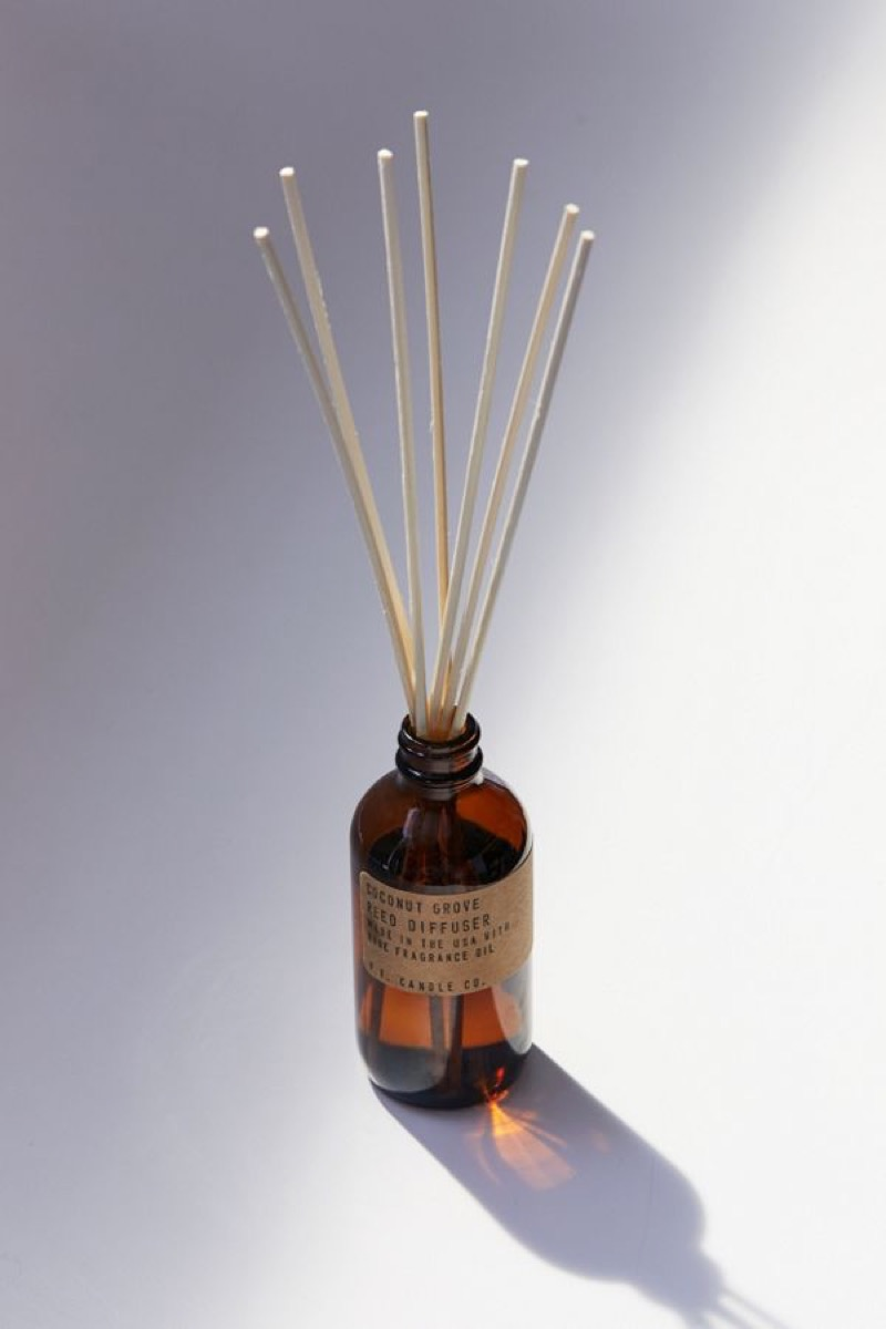 brown bottle with diffusing reeds coming out of the top