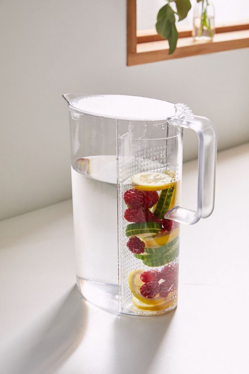 clear pitcher with fruit floating in it