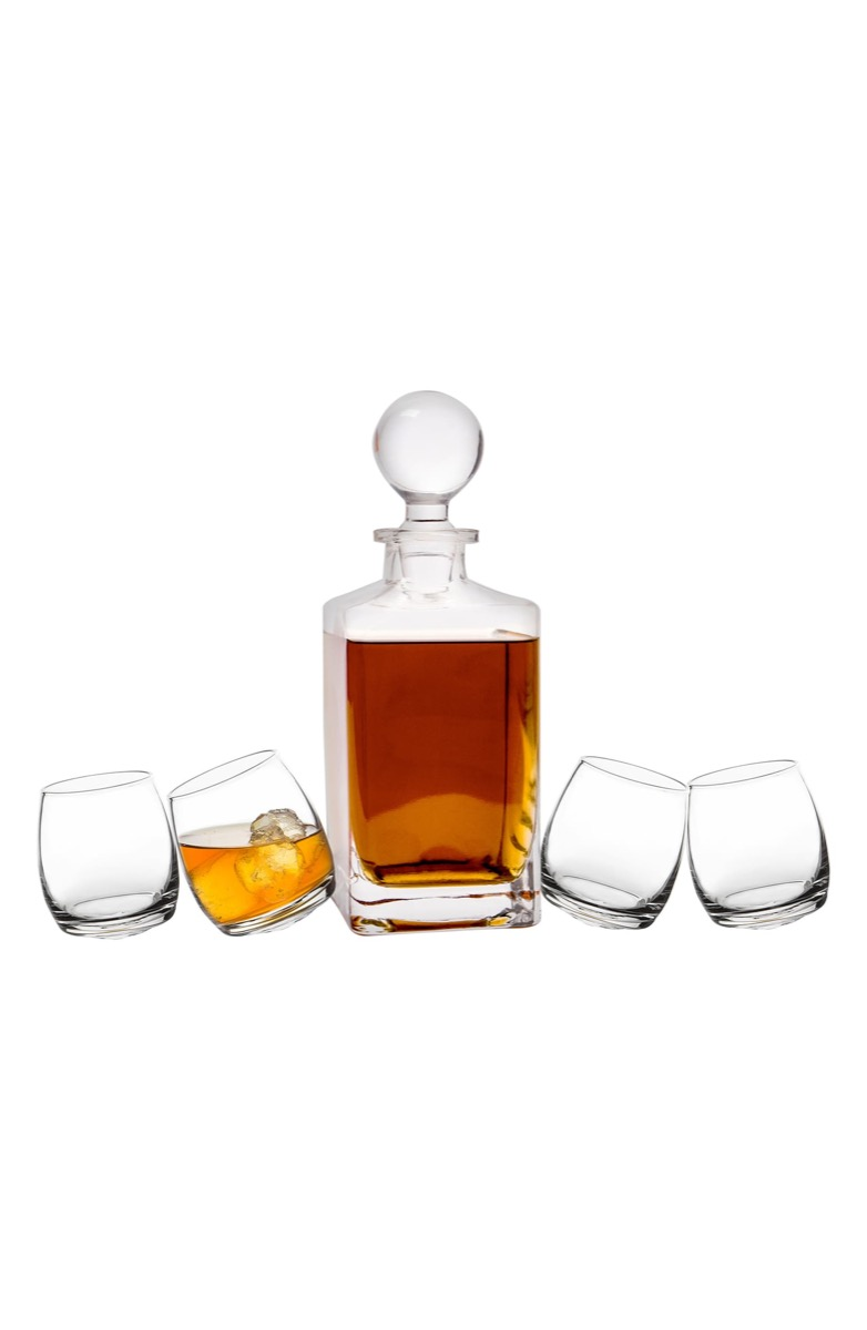 crystal decanter full of whiskey and four short glasses