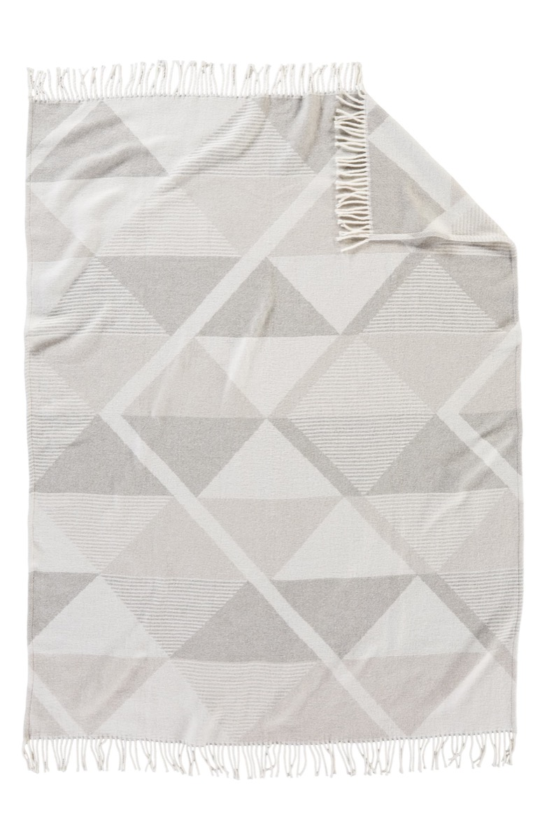 gray blanket with geometric pattern, housewarming gifts