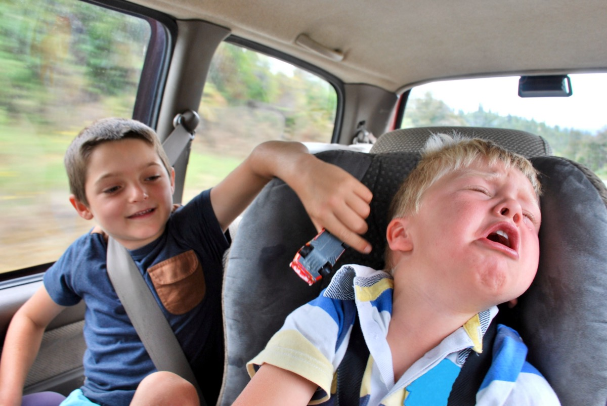 Kids Fighting During a Road trip 1990s Parents