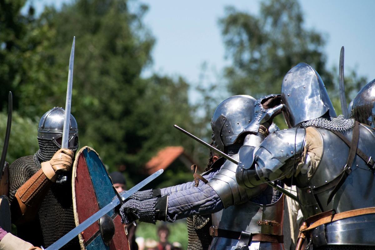 Three knights in medieval reenactment