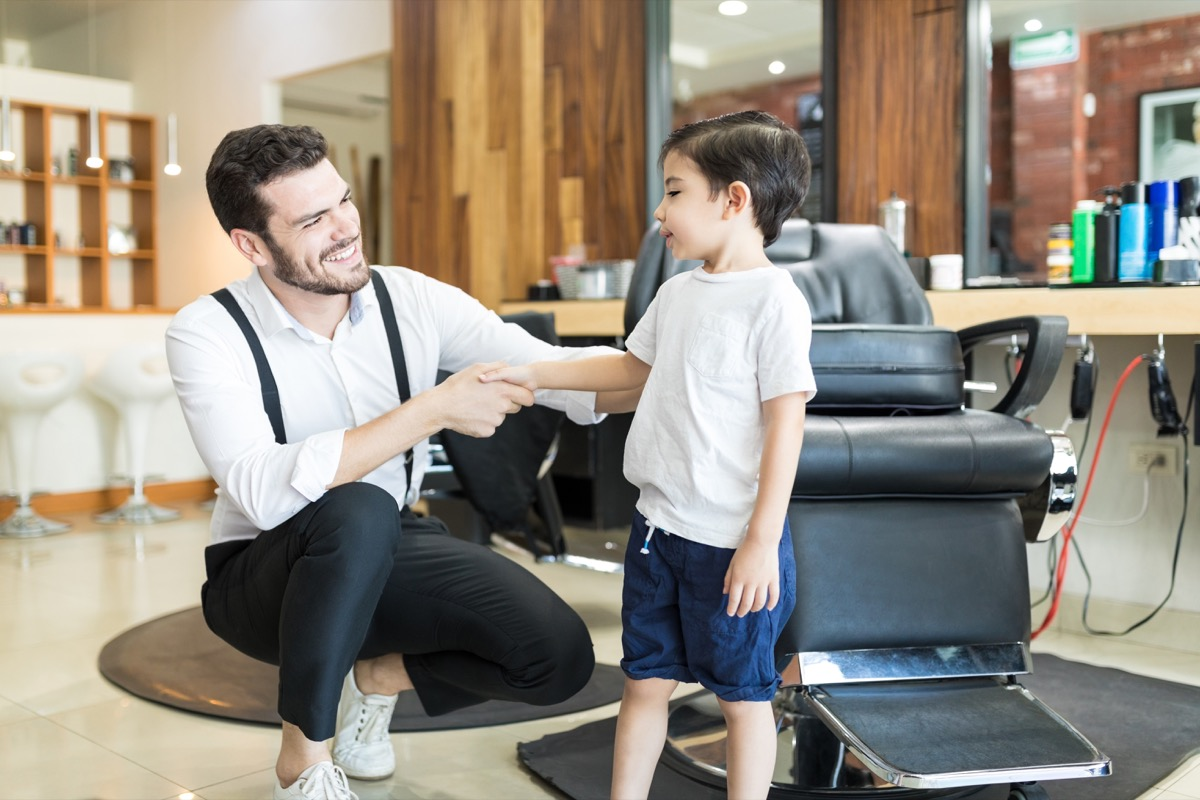 little boy shaking hands with barber old-fashioned manners