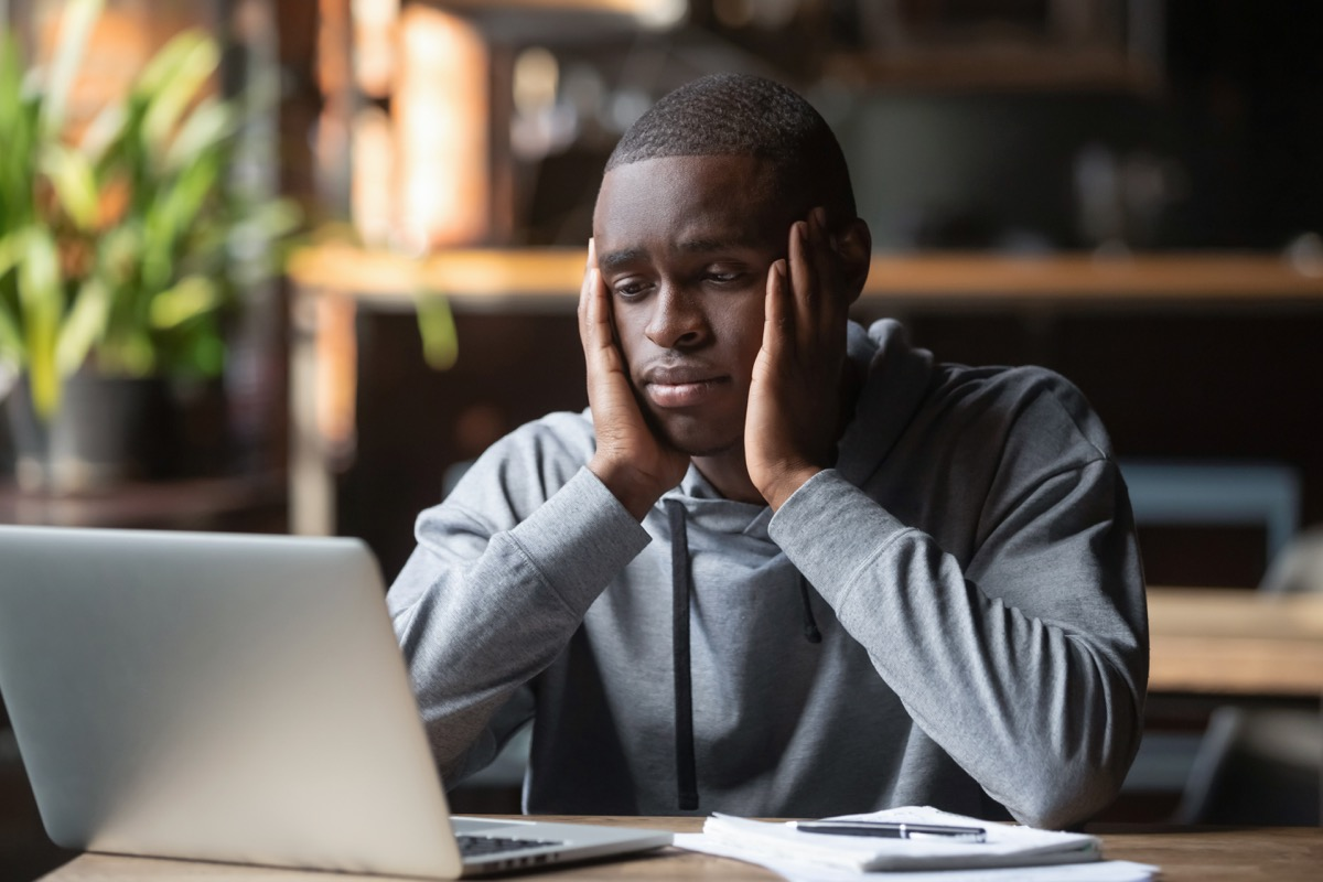 Black Man Looking Sad and Alone at Work Things that hurt your health