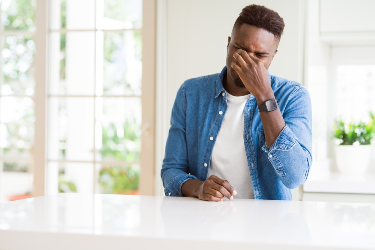 man smelling a bad smell at smelly home, signs your cold is serious