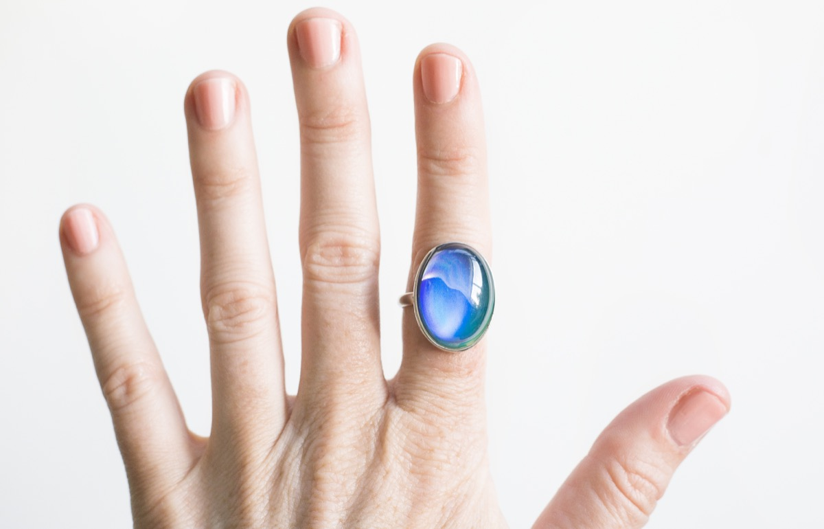 close up shot of a mood ring on a woman's hand