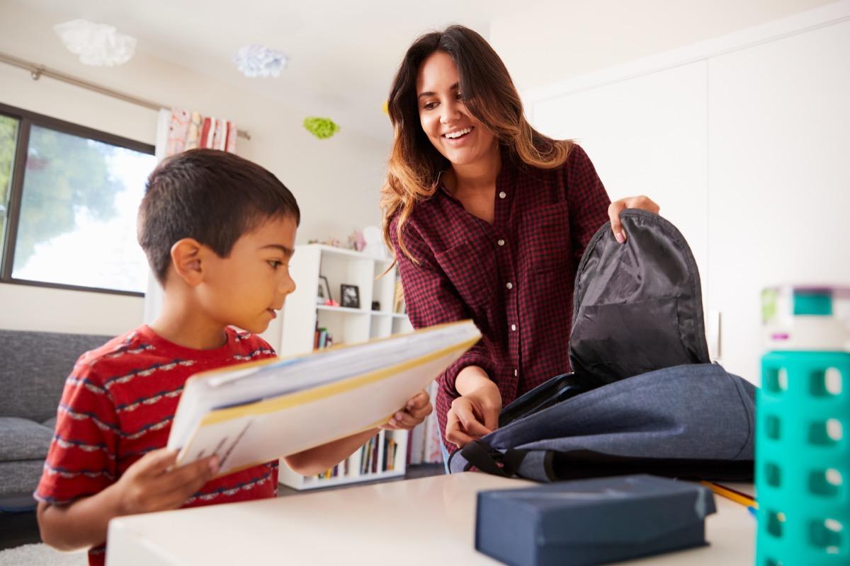mother packing kids book bag for school, lies parents teachers