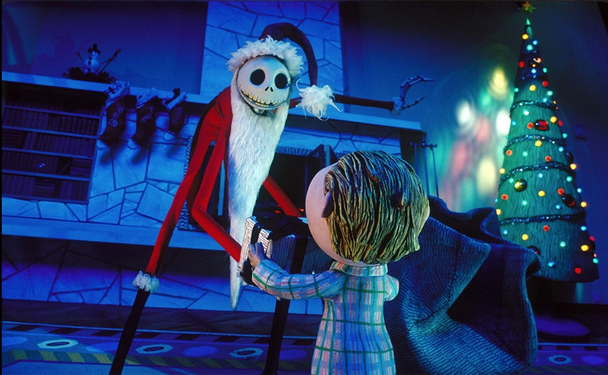 skeleton dressed as santa talking to little kid, nightmare before christmas still, best halloween movies for kids