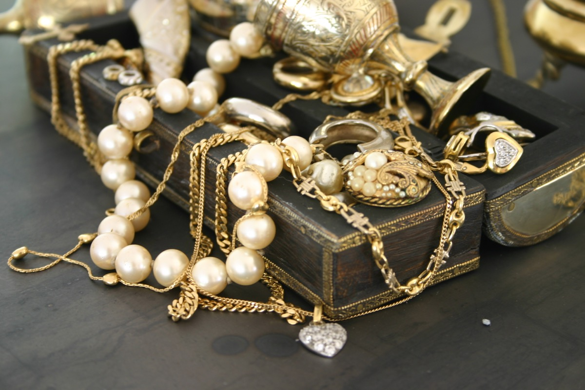 an old jewelry box with necklaces and bracelets, titanic artifacts