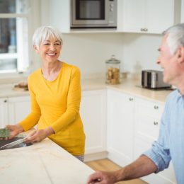 older white straight couple cleaning kitchen