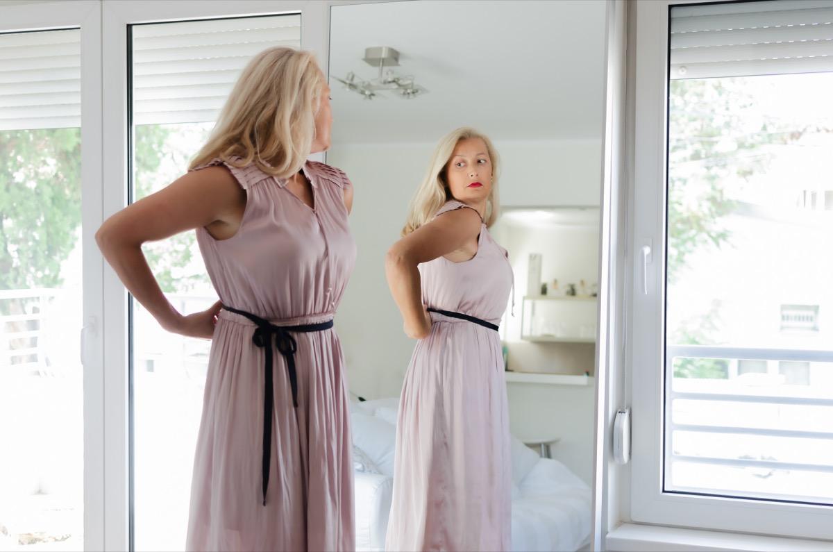 older woman looking in the mirror
