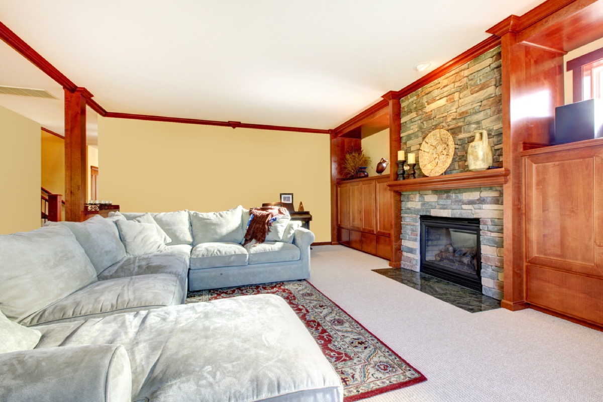 gray couch in living room, interior design mistakes