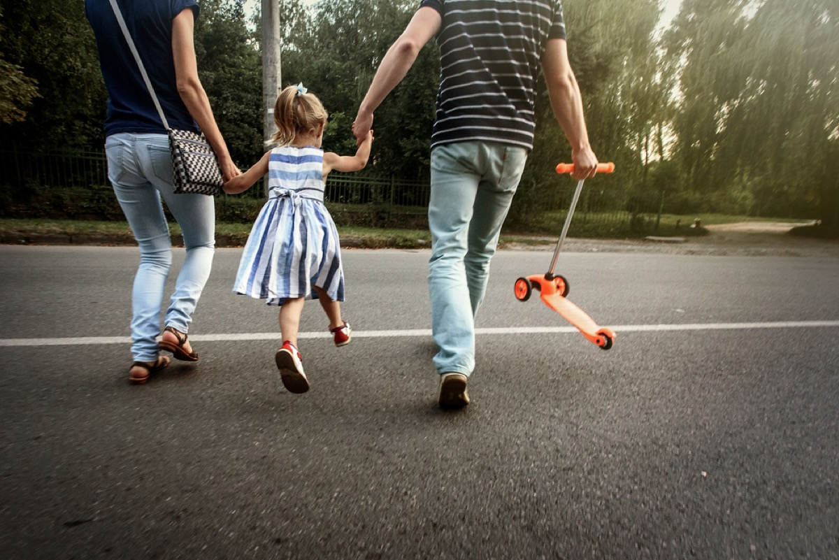parents crossing street with daughter, things you should never lie to kids about