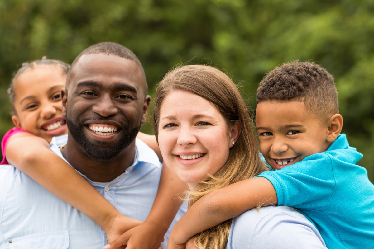 interracial couple with two children outdoors, bad parenting advice