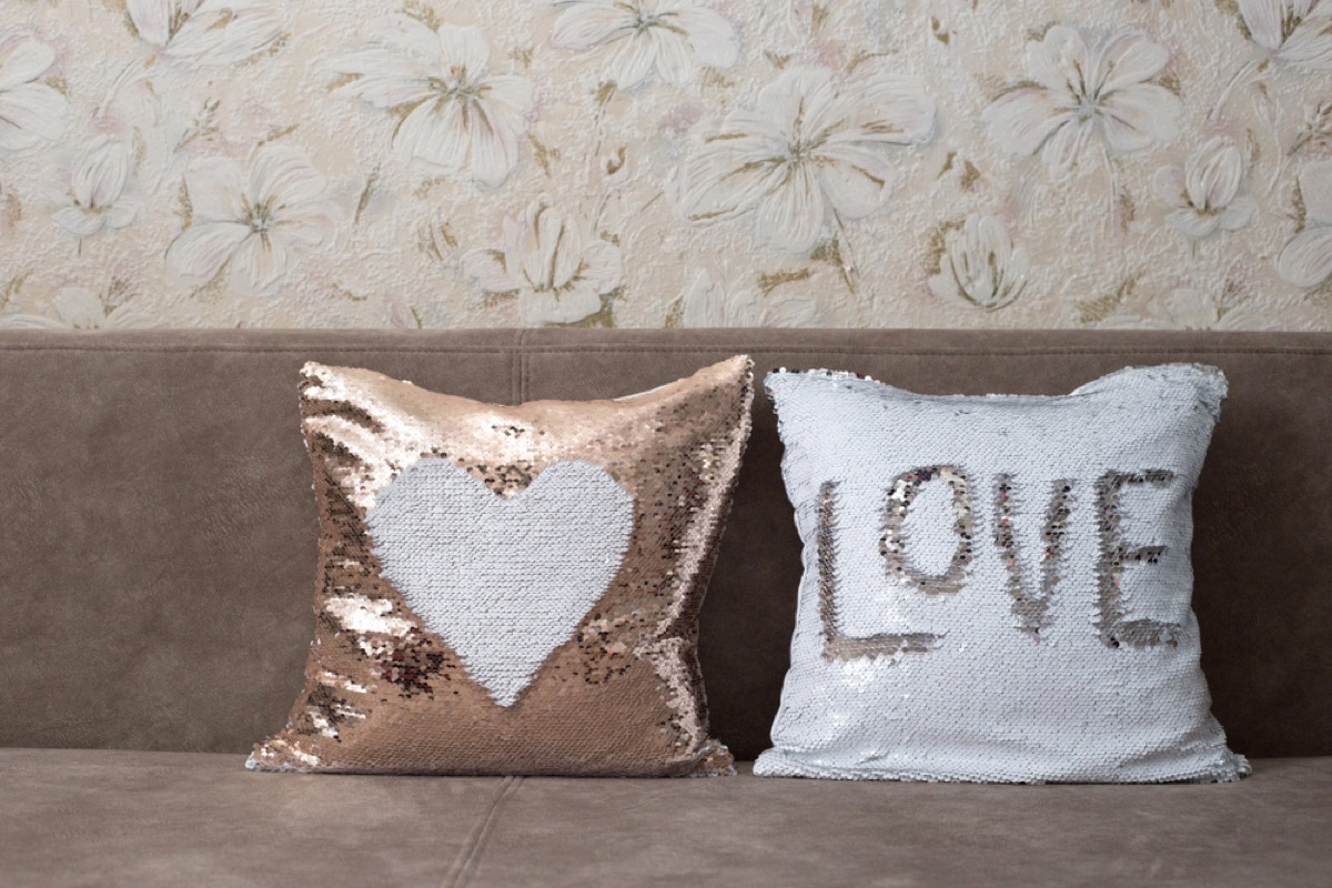 sequin pillows on couch, interior design mistakes