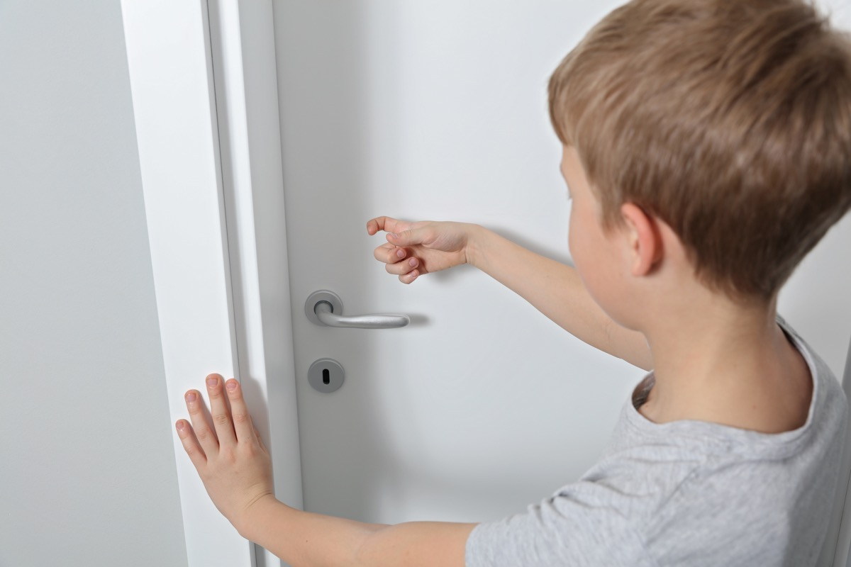 small boy knocks on door in home old-fashioned manners