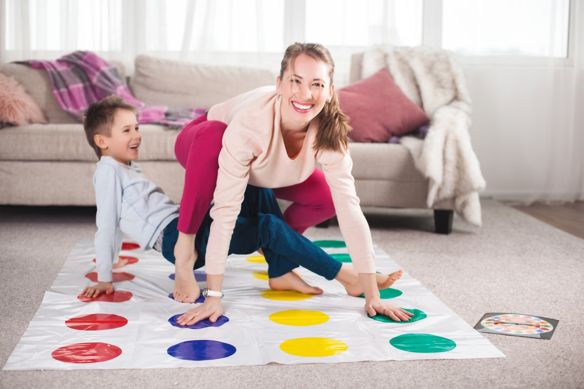 mom and son playing twister