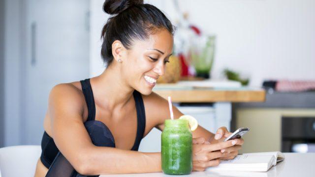 woman drinking green juice, ways to feel amazing