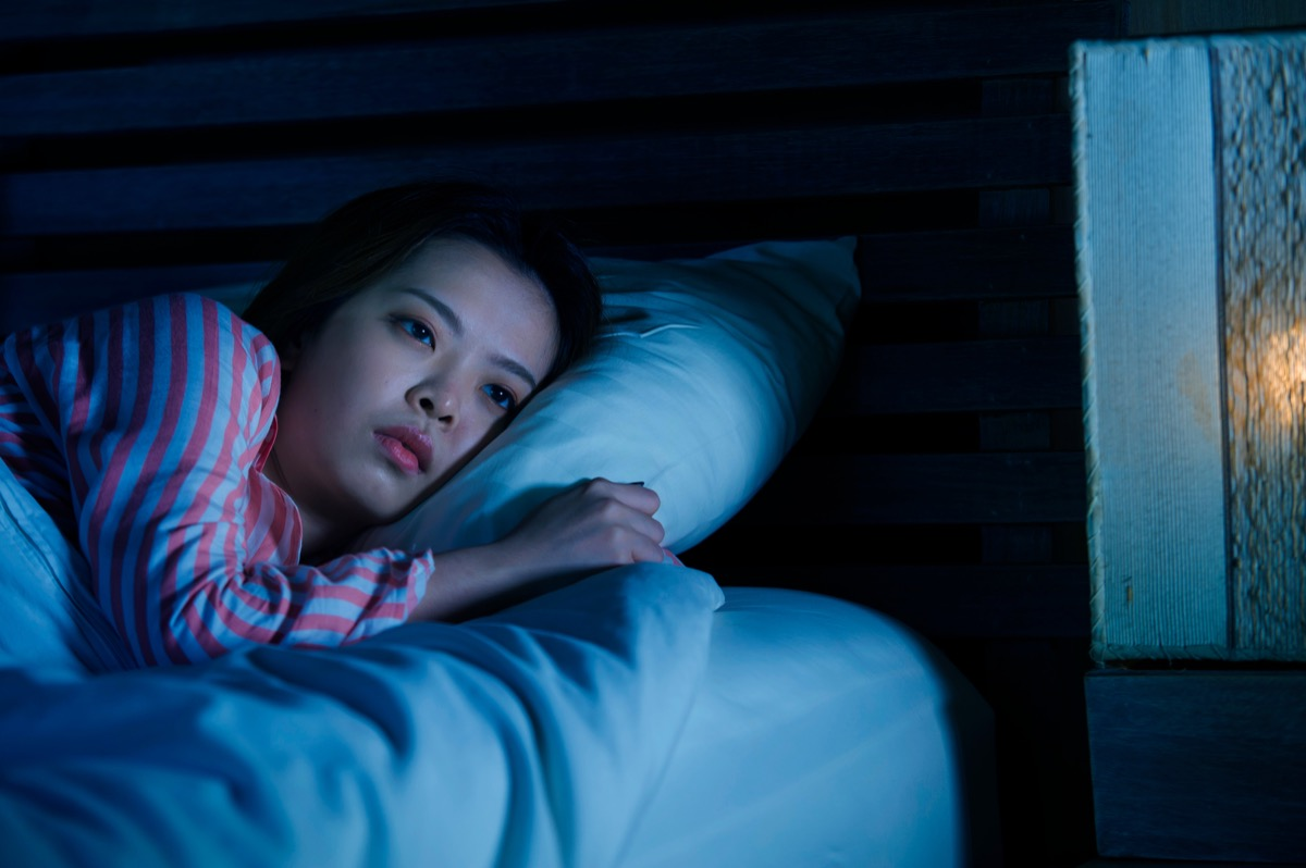 woman awake in bed with insomnia horrify sleep doctors