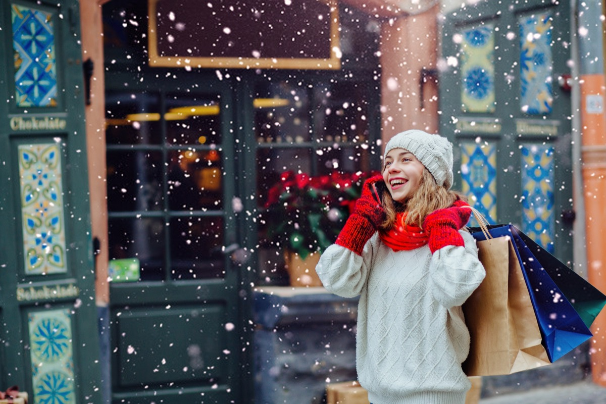 Woman talking on the phone while holiday shopping