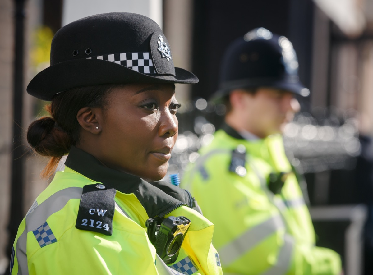 woman police officer standing traffic stop