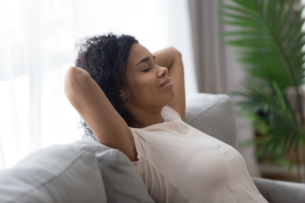 Woman Relaxing and Being Lazy on the Couch High Cholesterol