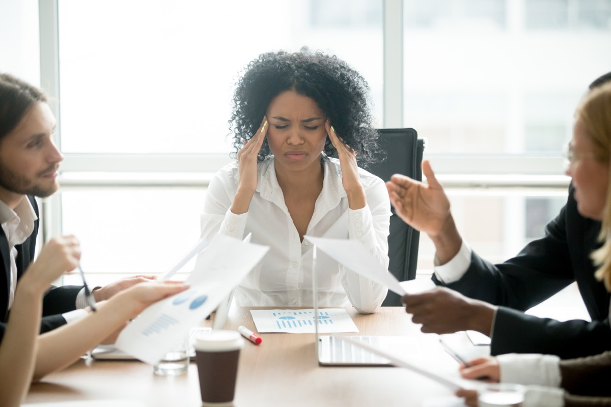 Woman stressed at her desk at work things that hurt your health
