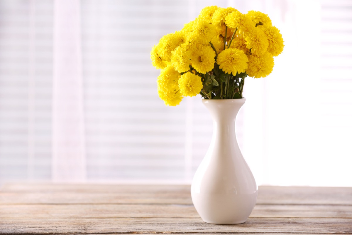 yellow flowers in white vase, old school cleaning tips