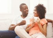 young black couple drinking coffee at home