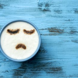 Cappuccino with frown art