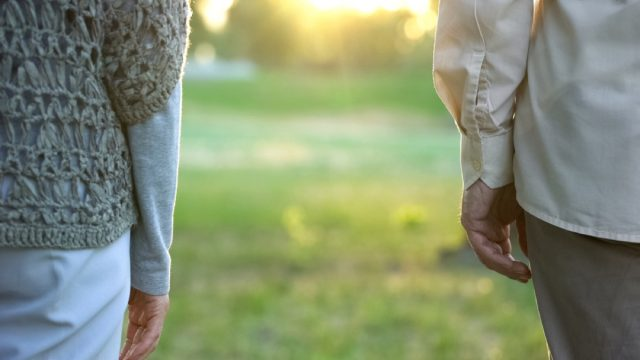 Older Couple Standing Apart, stopped having sex in marriage