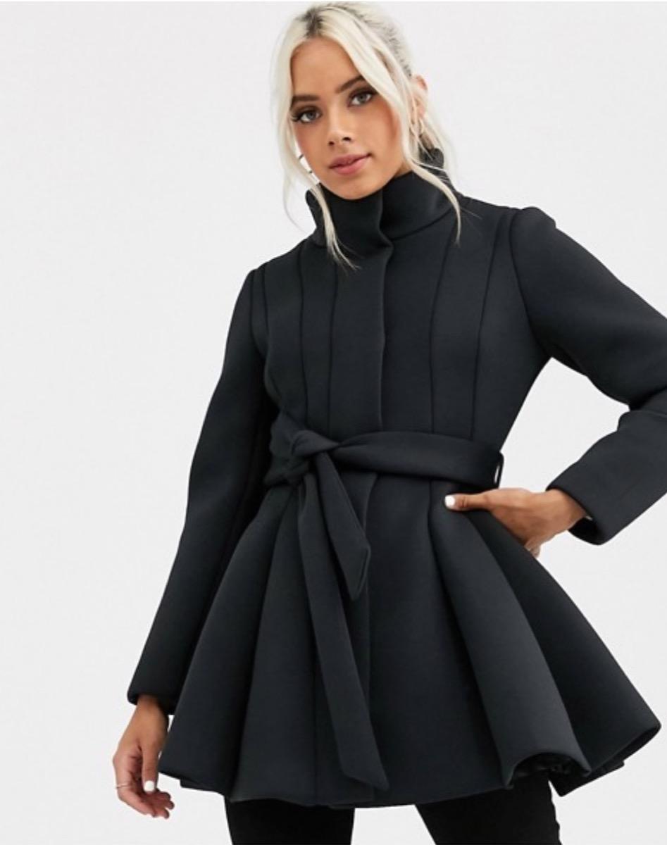blonde woman in black flared coat, women's coats for winter