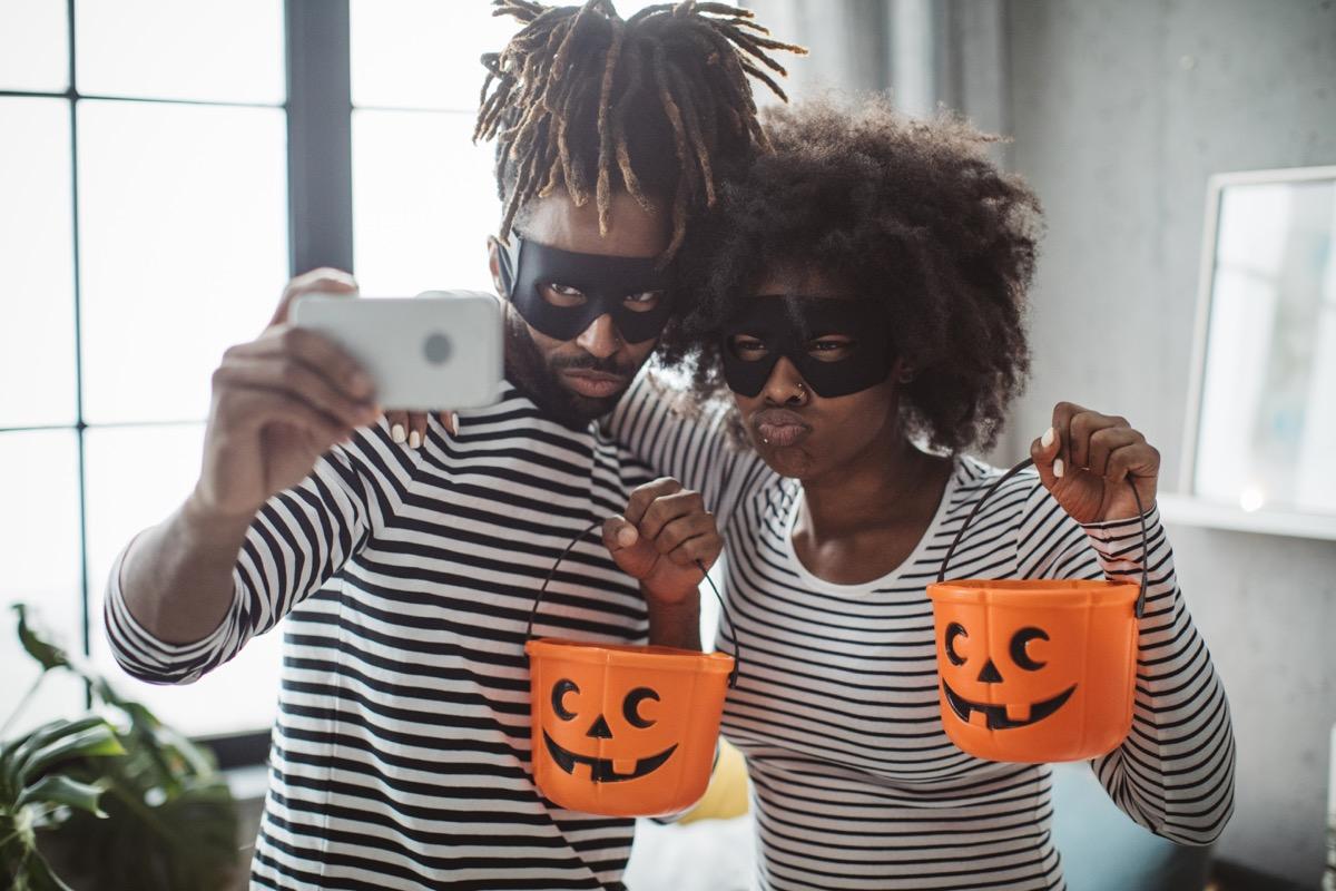 Young couple celebrating Halloween