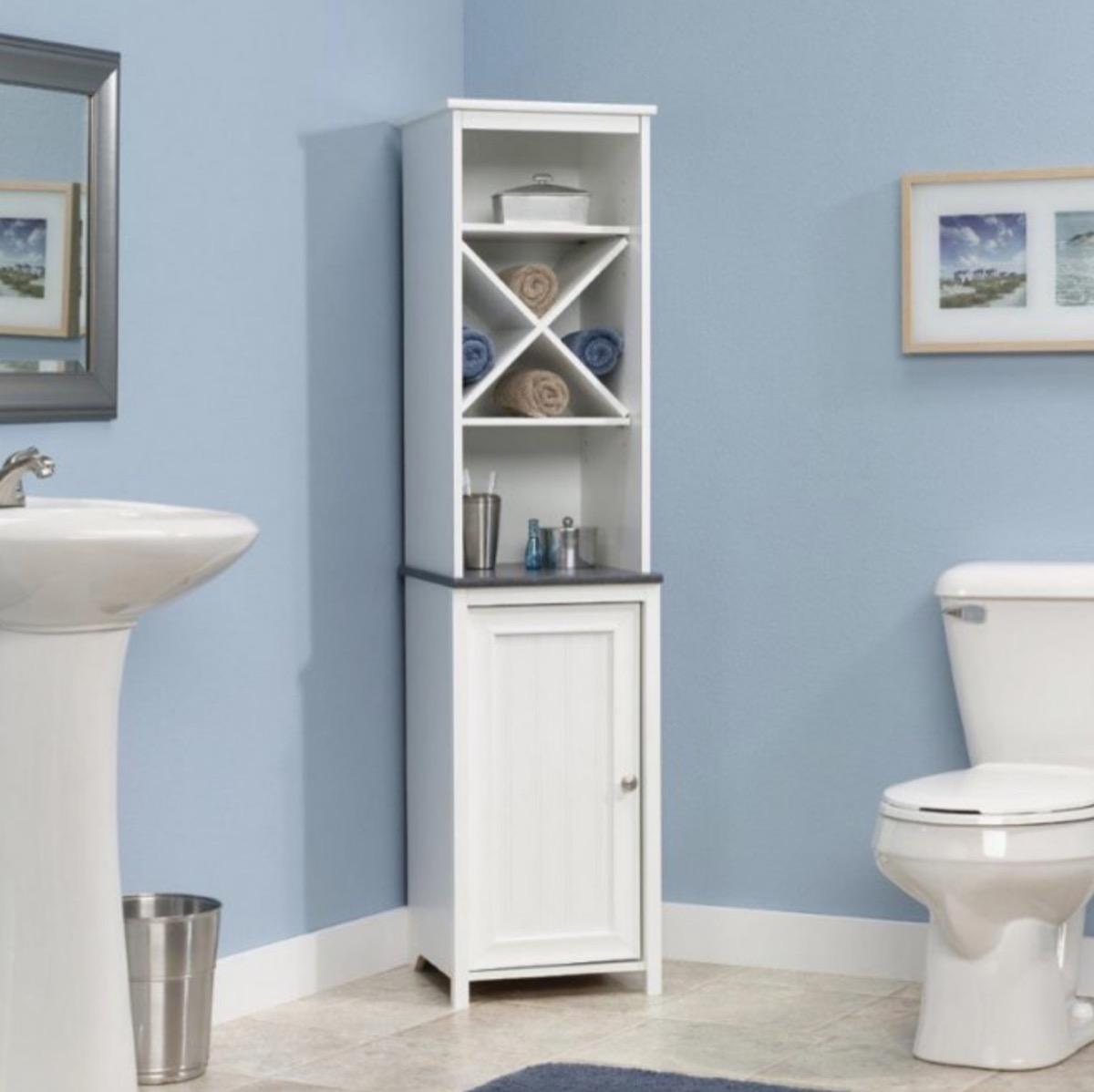 white storage cabinet in blue bathroom, bathroom accessories