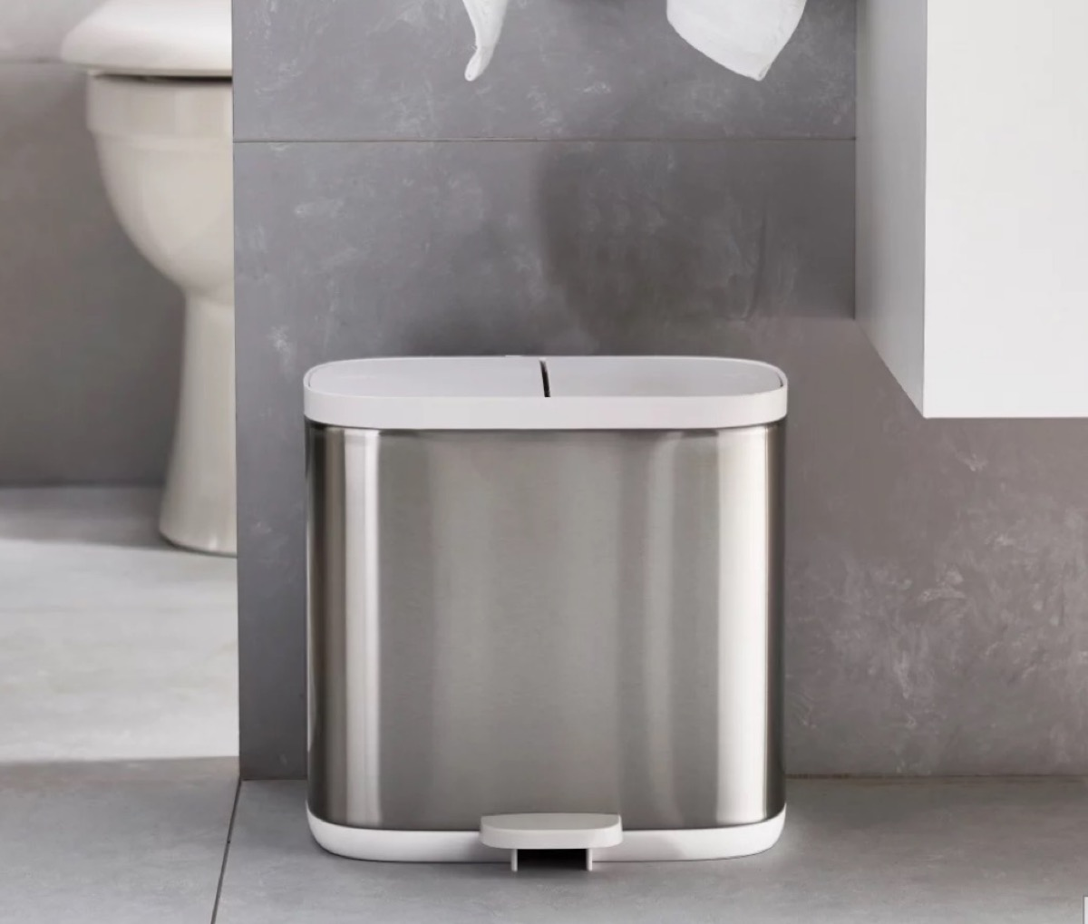 silver trash can with white top in a modern bathroom, bathroom accessories