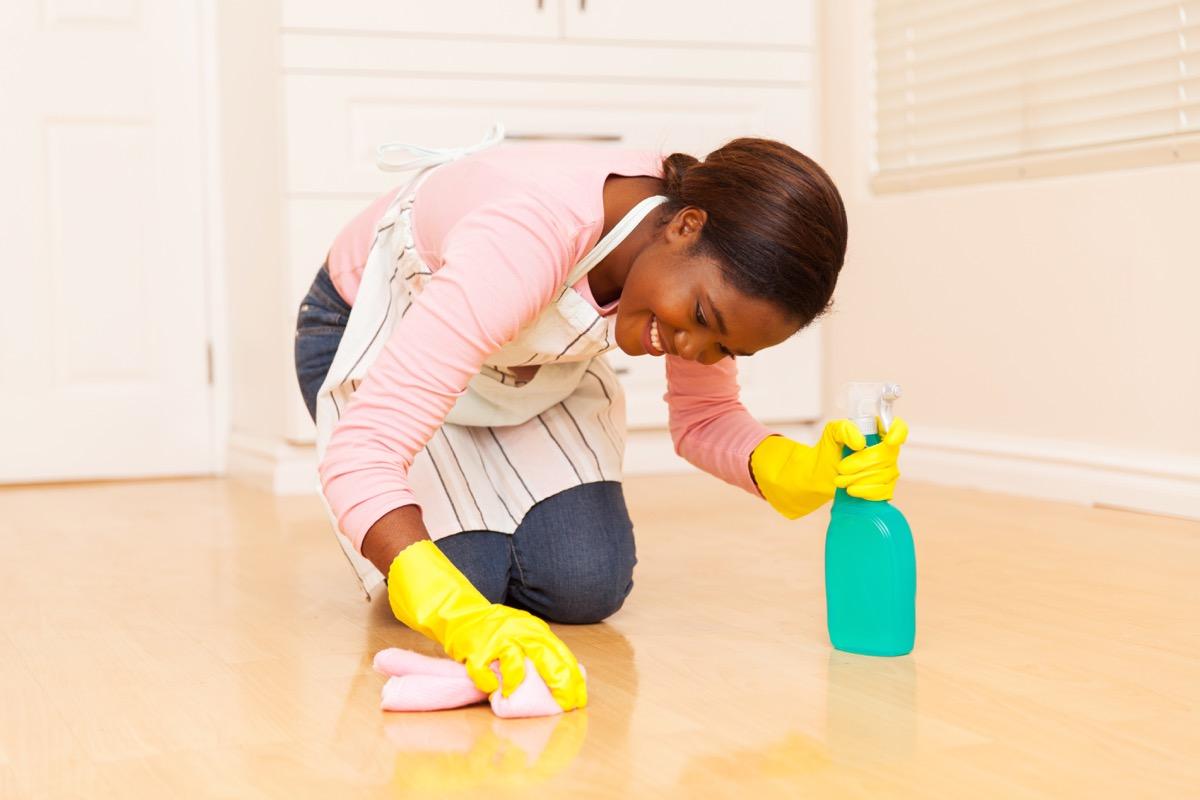 young black woman polishing floor