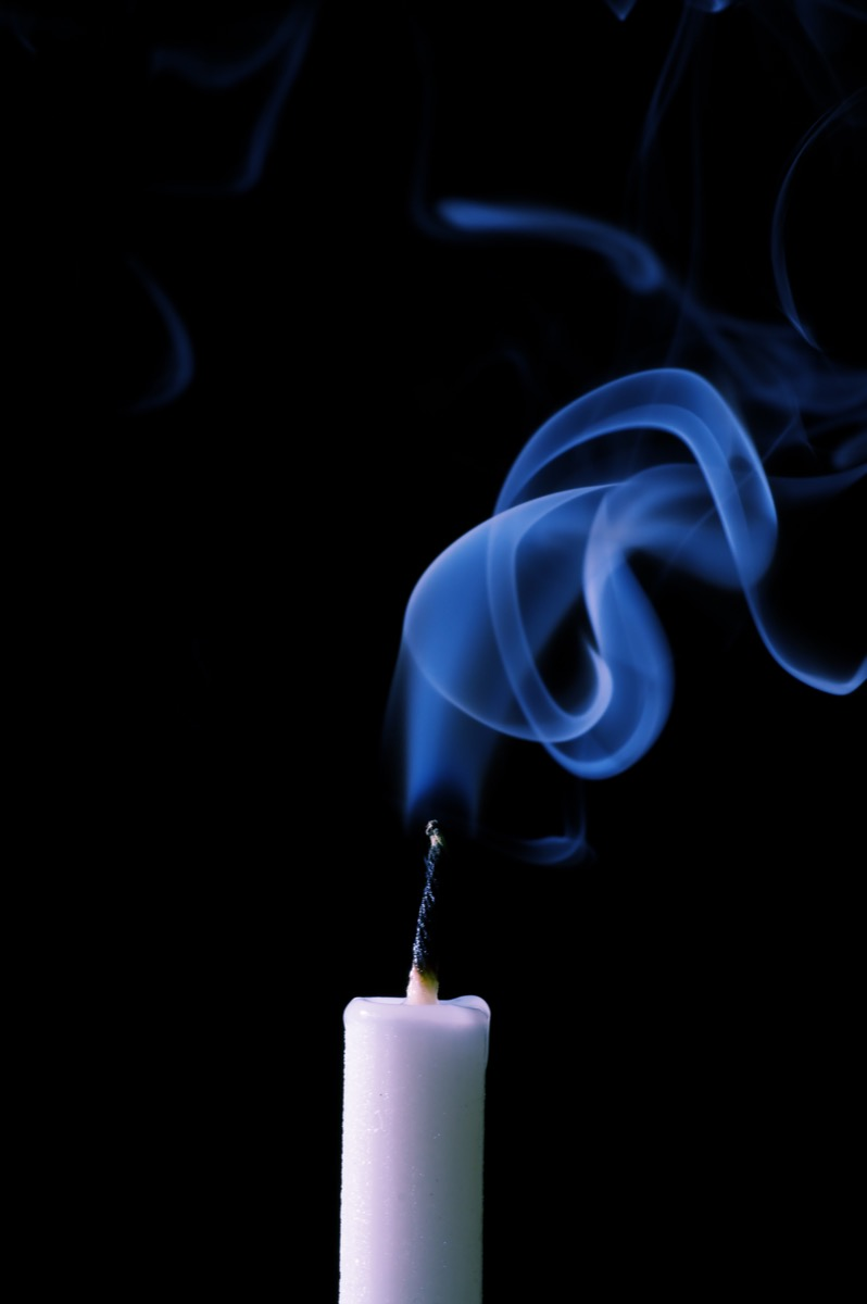 candle with blue flame