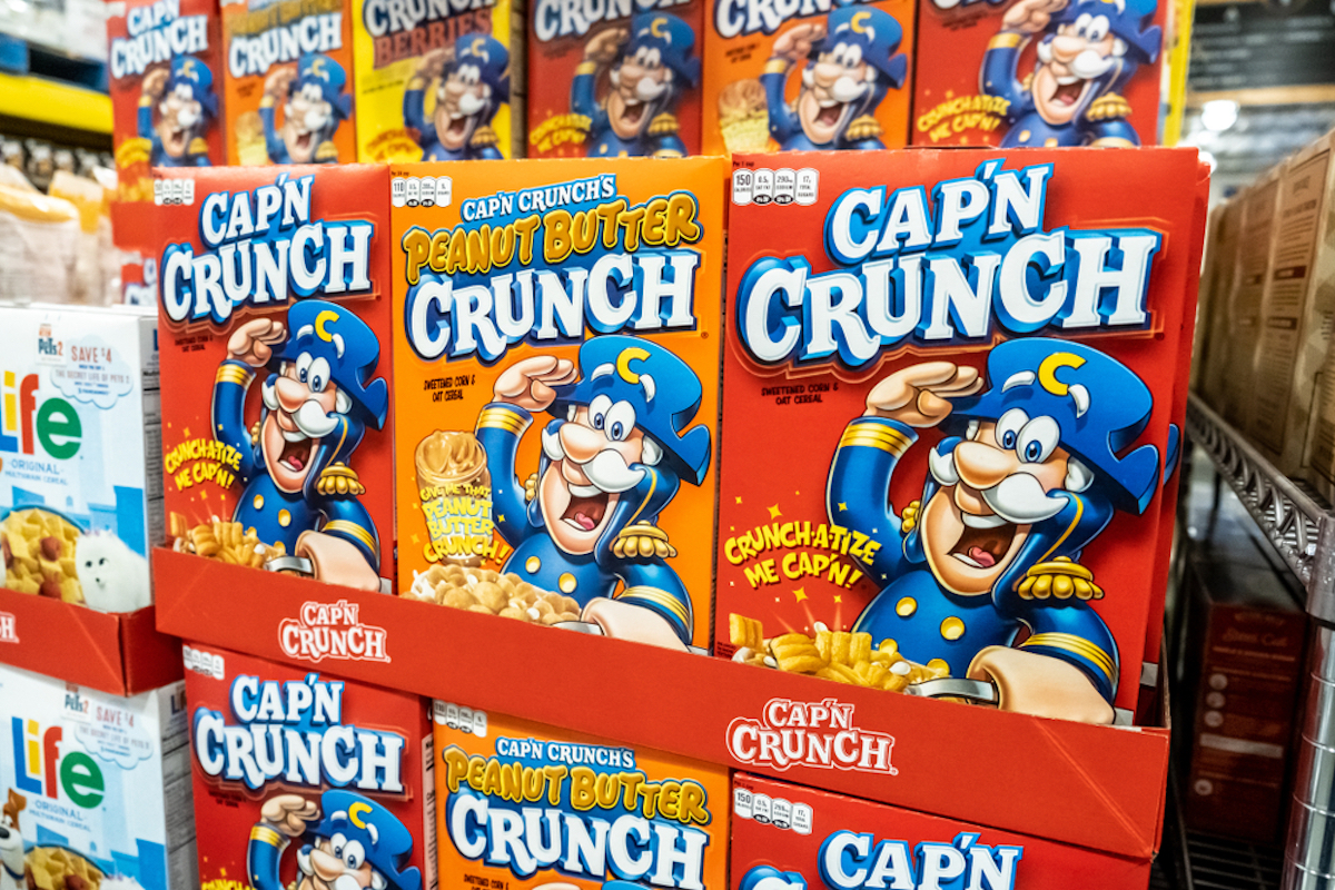 boxes of original capn crunch and peanut butter capn crunch at the supermarket